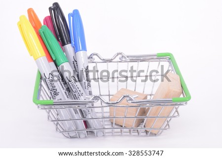 Kuala Lumpur, Malaysia - Sept 10, 2015: Sharpie pen with wooden block in a basket.