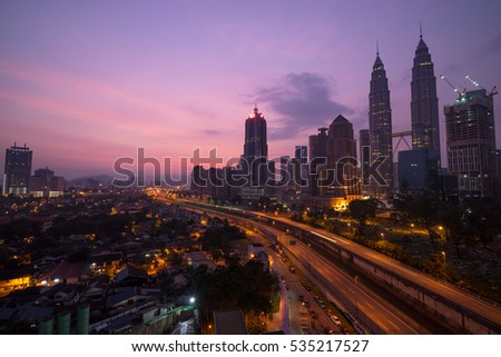 KUALA LUMPUR,MALAYSIA - 17TH APRIL 2016; A cloudy sunrise in Kuala Lumpur, the capital of Malaysia. Its modern skyline is dominated by the 451m tall KLCC, a pair of glass and steel clad skyscrapers.