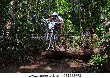 KUANTAN - NOVEMBER 8: unidentified mountain biker in action during training for downhill challenge on November 8, 2014 in Teluk Cempedak, Kuantan, Pahang, Malaysia.
