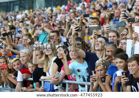 KYIV, UKRAINE - AUGUST 29, 2016: Young football supporters watch the Open training session of Ukraine National Football Team before FIFA World Cup 2018 Qualifying matches at NSC Olympic stadium