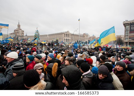 KYIV, UKRAINE - DEC 8: Crazy crowd on the occupying Maidan square moving on the demostration during two weeks anti-government protest on December 8, 2013, in Kiev, Ukraine.