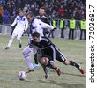 KYIV, UKRAINE - FEBRUARY 24: Oleg Gusev of Dynamo Kyiv (#20, in white) fights for a ball with Roberto Hilbert of Besiktas (#9) during their UEFA Europa League game on February 24,2011 in Kyiv, Ukraine - stock photo