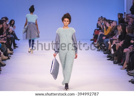 KYIV, UKRAINE - MARCH 21, 2016: Models walk on the catwalk during Fashion Show by Olga May as part of 38th Ukrainian Fashion Week at Mystetskyi Arsenal in Kyiv, Ukraine