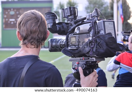 KyiV, UKRAINE - September 2, 2016: Videographer with the camera shoots a football field during the qualifying round UEFA Euro-2017 between Ukraine U21 vs France U21, 2 September 2016, Ukraine