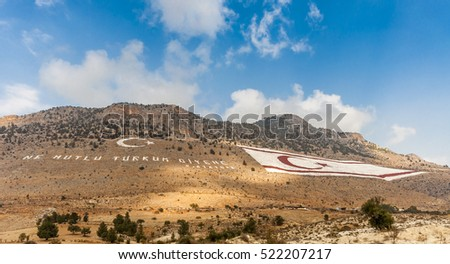 Kyrenia, Cyprus - November 16, 2013 : A flag of Northern Cyprus is painted on the southern slope of the Kyrenia Mountains. It is 425 metres wide and 250 metres high,