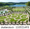 L'Orangerie garden and pond in Versailles palace - stock photo