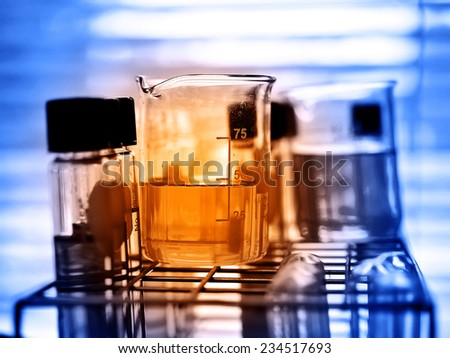 Laboratory research, beaker containing chemical liquid