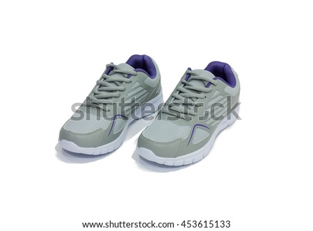 Ladies blue and gray running shoes on white background