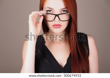 lady boss fashion portrait of Beautiful girl model with red hair.young business woman with tablet PC