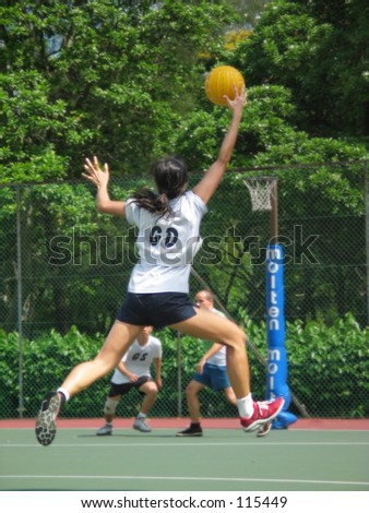 Lady reaching for a Netball
