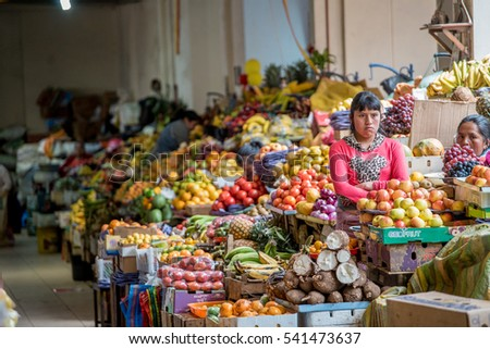 Lady selling fruit on local market Cuenca, Peru Sept 8th 2016