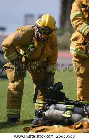 LAGUNA BEACH, CA - FEB 19: Firefighter recruits take a break during fire fighting drills at the local Fire Department training area on February 19, 2009 in Laguna Beach, California.