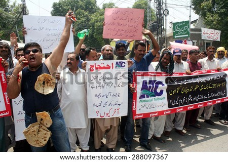 LAHORE, PAKISTAN - JUN 17: Employees of National Telecom chant slogans against anti-people budget 2015-16 during protest demonstration on June 17, 2015 in Lahore.