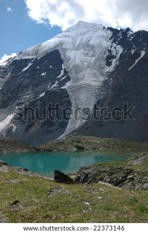 Lake in mountains of Altai with reflection of mountains