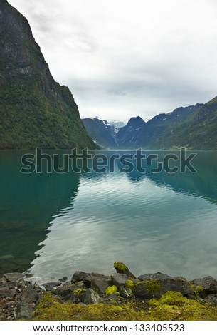 Lake Oldenvatnet with the glacier Briksdal, Norway.