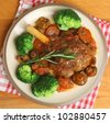 Lamb shank with broccoli dinner - stock photo