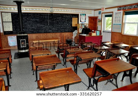 Lancaster, Pennsylvania - October 18, 2015:  Interior of the one room Willow Lane schoolhouse with wooden desks at the Amish Farm and House Museum