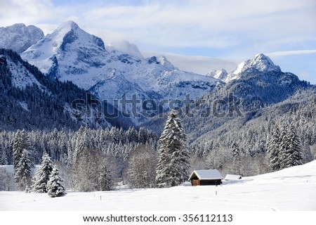 landscape in Bavaria with mountains at winter in snow