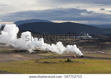 Landscape in Iceland with a large plume of smoke, Krafla geothermal power station