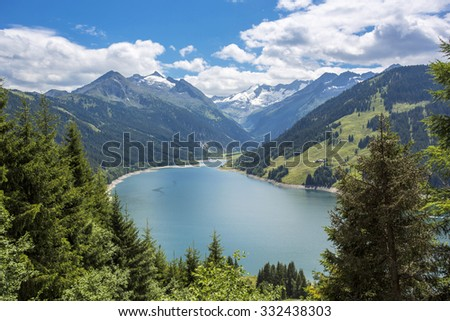 Landscape of a small turquoise lake and mountains from the Dolomite, Italy
