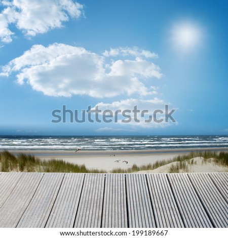 Landscape of a wooden jetty overlooking the sea with a sunny background