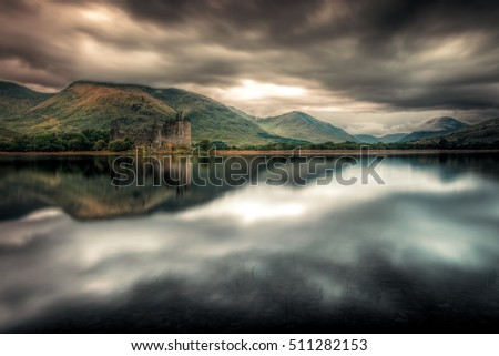 Landscape of Scotland during stormy weather: Kilchurn Castle in the dark. Loch Awe in Argyll and Bute - Highlands