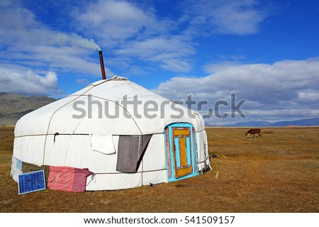 Landscape of yurt traditional nomadic homes for Western Mongolians on the steppe with beautiful blue sky background