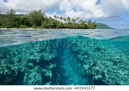 Landscape over and under water surface, tropical island shore with natural trench into the fore reef split by waterline, Huahine, Pacific ocean, French Polynesia