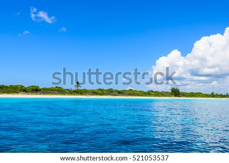 landscape view of the open blue sea blue sky with white cumulus clouds summer