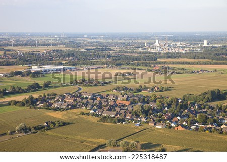 Landscape with homes, industry and agriculture in the Lower Rhine Region of Germany - Aerial view of Kamp-Lintfort, North Rhine-Westfalia, Germany, Europe