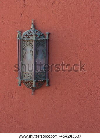 Lantern hanging on a red wall