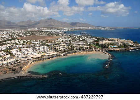 LANZAROTE, CANARY ISLANDS - SEPTEMBER 27, 2007: Aerial view of the coast of Playa Blanca