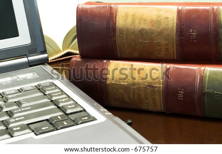 Laptop and Legal books on table - South African Law Reports