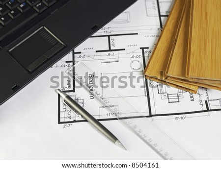 Laptop and wood on blueprint