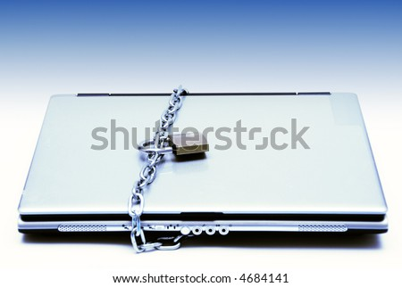 laptop computer secured with chain and lock