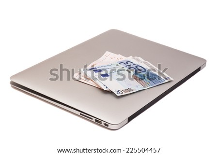 Laptop With Dollars And Euro money