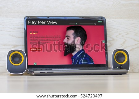 Laptop with pay per view website on the screen and external speakers to the sides. All screen graphics are made up.
