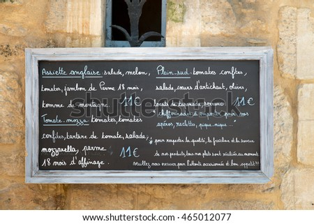 Large chalk board with restaurant menu in France
