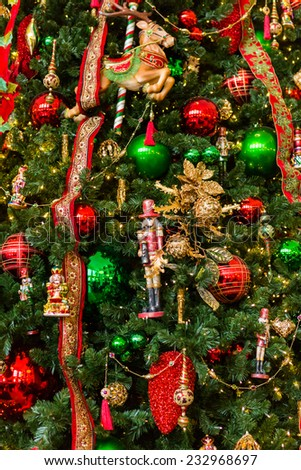 Large CHristmas tree decorated with bright ornaments.