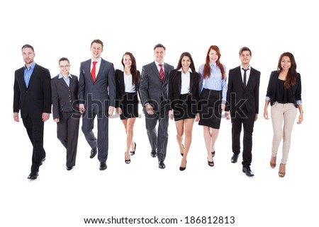 Large group of business people walking towards camera. Isolated on white