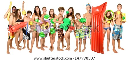 Large group of  teenagers with funny beach gear for kids