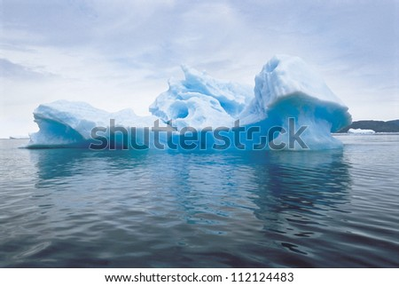 Large Iceberg with clouds
