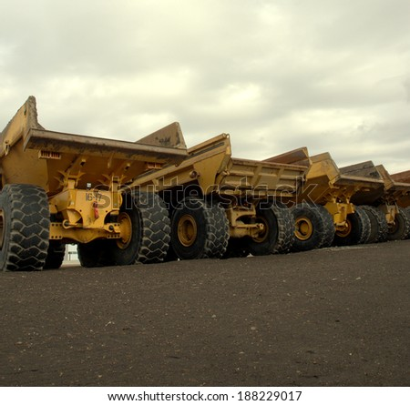 Large off road dump trucks lined up awaiting their next assignment