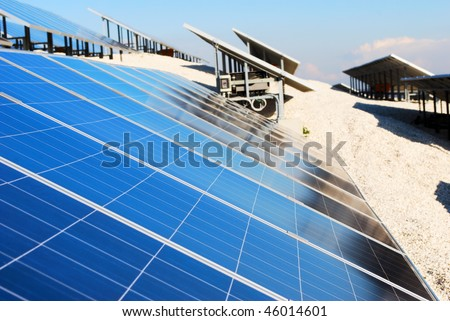 Large solar panel installation (selective focus on panel in foreground)
