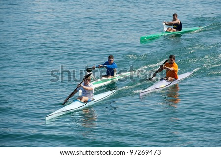 LAS PALMAS, SPAIN - MARCH 11: Unidentified men from club amigos del piraguismo in Canary Islands, kayaking during Boat and Marine Expo FIMAR 2012 on March 11, 2012 in Las Palmas, Spain