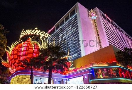 LAS VEGAS - DEC 13 : The Flamingo hotel and casino sign on December 13 , 2012 in Las Vegas. Las Vegas in 2012 is projected to break the all-time visitor volume record of 39-plus million visitors