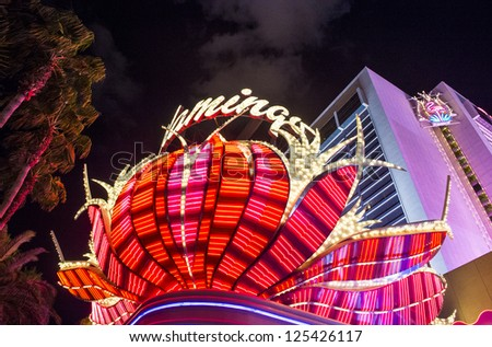 LAS VEGAS - DEC 13 : The Flamingo hotel and casino sign on December 13 2012 in Las Vegas. Las Vegas in 2012 is projected to break the all-time visitor volume record of 39-plus million visitors