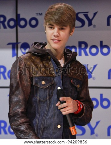 LAS VEGAS - JAN 11: Justin Bieber makes an appearance at the mRobo booth at the 2012 Consumer Electronics Show at The Las Vegas Convention Center in Las Vegas, NV on January 11,  2012.