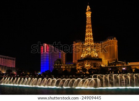 "LAS VEGAS - MAY 2: The musical fountains of the Bellagio Hotel are shown in front of the Eiffel Tower of the hotel ""Paris"" May 2, 2007 in Las Vegas."