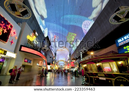 Las Vegas, Nevada, USA - September 24, 2014: Tourists enjoying the nightlife on the famous Fremont Street promenade Las Vegas, Nevada on  September 24, 2014.
